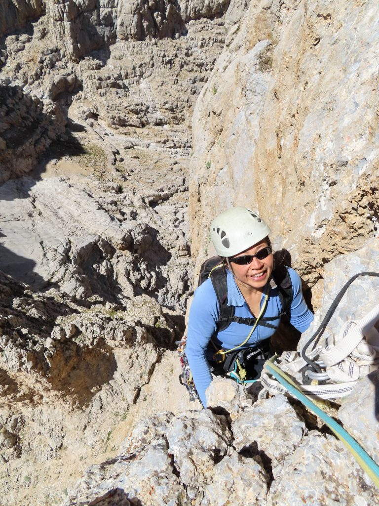 Shirley arriving on a nice ledge that is the top of pitch 2 (August 2020).